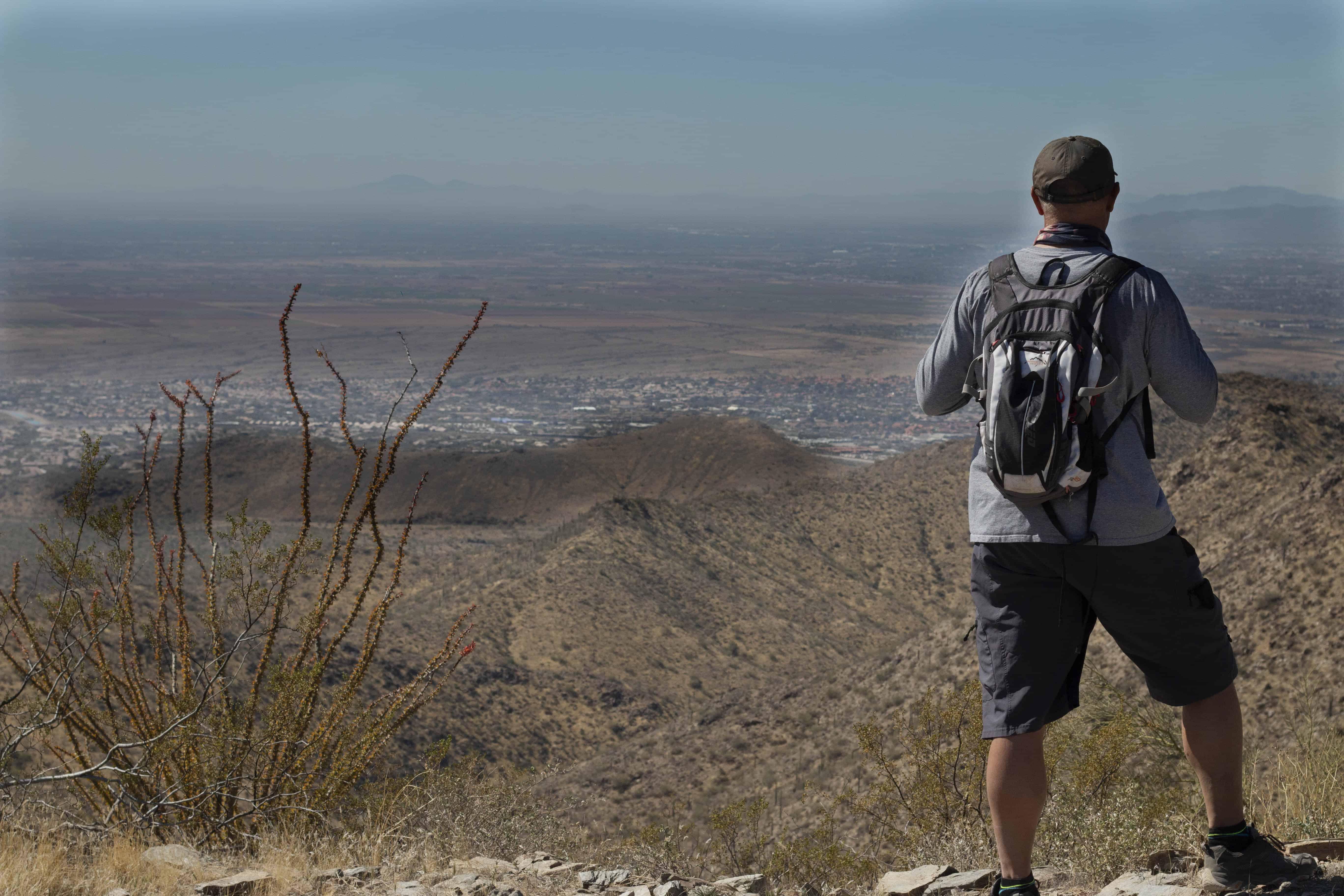 Male hiker on top of Thompson Peak, AZ