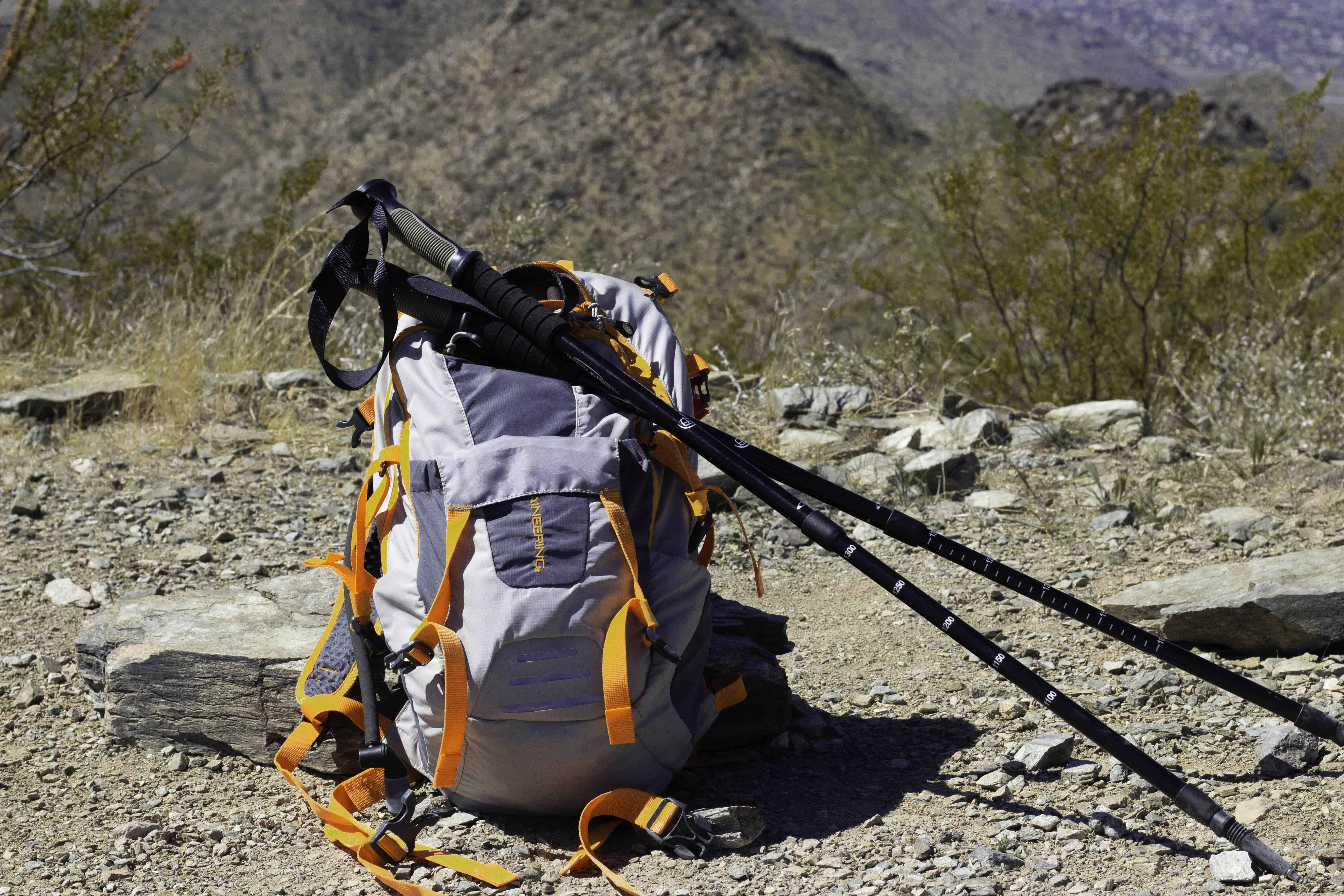 Backpack and hiking poles sitting on top of Thompson Peak